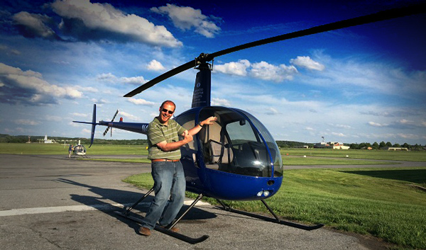 Ian Twombly converted across to helicopters in 2014 and this is a photo after completing his checkride.