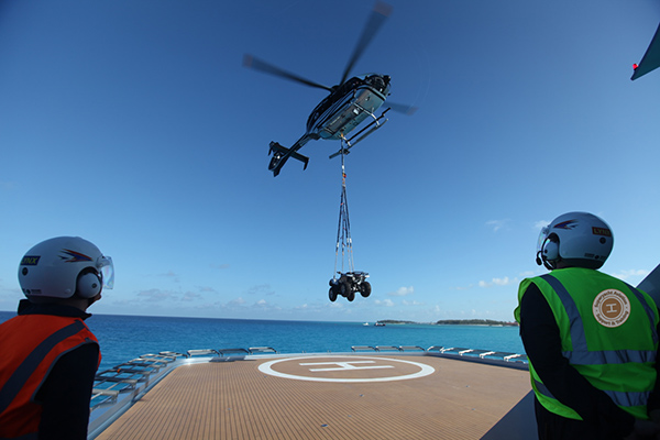 Helicopter sling load from private yacht helideck