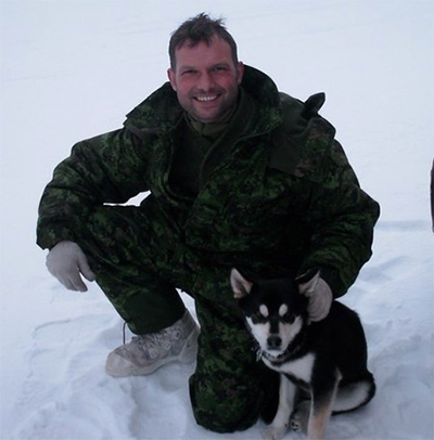 John training in the snow with UK military