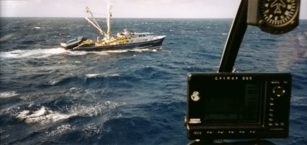 A typical tuna fishing boat - the only dry landing spot within fuel endurance.