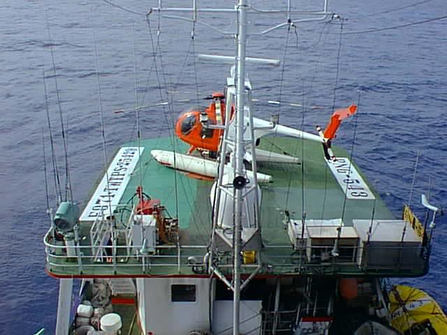 The helideck is usually located on top of the vessel bridge and in front of the lookout and radio masts.