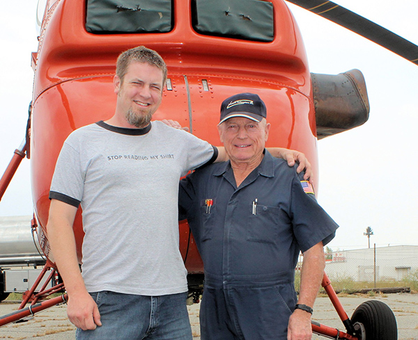 Doug Williams and Pete Gilies standing in front of a Sikorsky S-58T helicopter