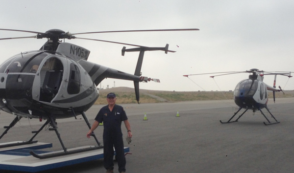 Pete on the tarmac with some MD500s
