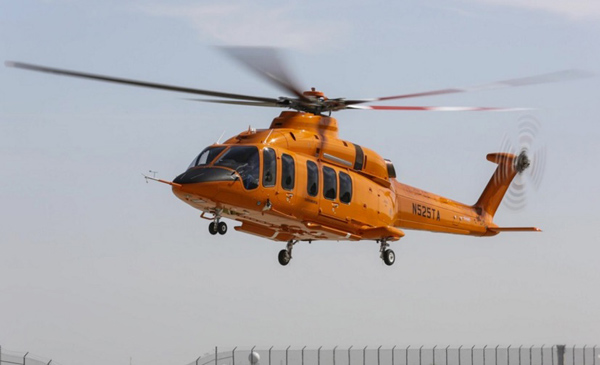 Bell 525 Flight Test Vehicle 1 - hard to see in this smaller image but the signatures of the customer advisory group have been painted on the tailboom. Photo Credit: Bell Helicopter