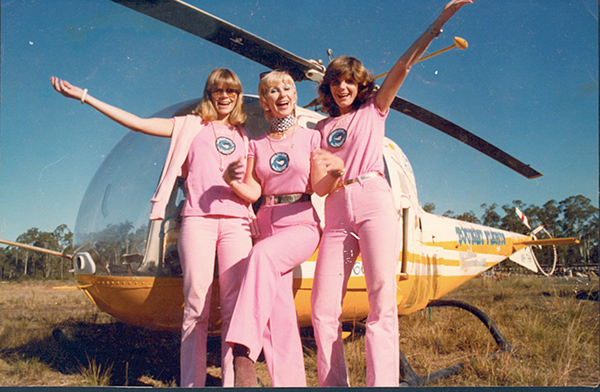 Rosemary and daughters who acted as her ground crew in front of Bell 47 VH-THH with its floral paint scheme.