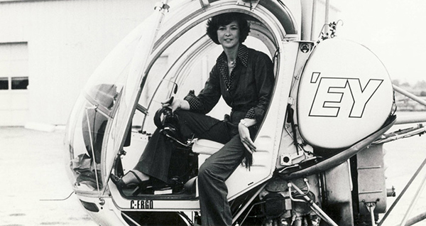 Dini posing at the controls of the helicopter that she flew as traffic reporter in Toronto.
