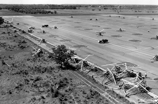 On 4/13/67 a heavy wind storm, possibly a tornado, struck the Downing Heliport damaging 179 TH-55A helicopters.